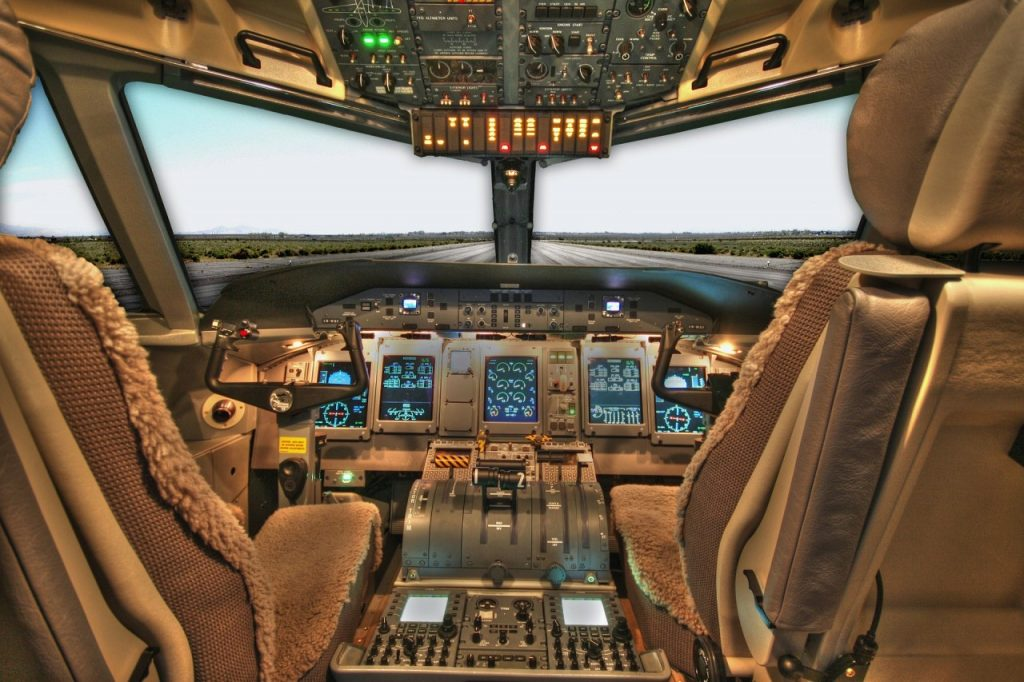 cockpit of plane from behind seats