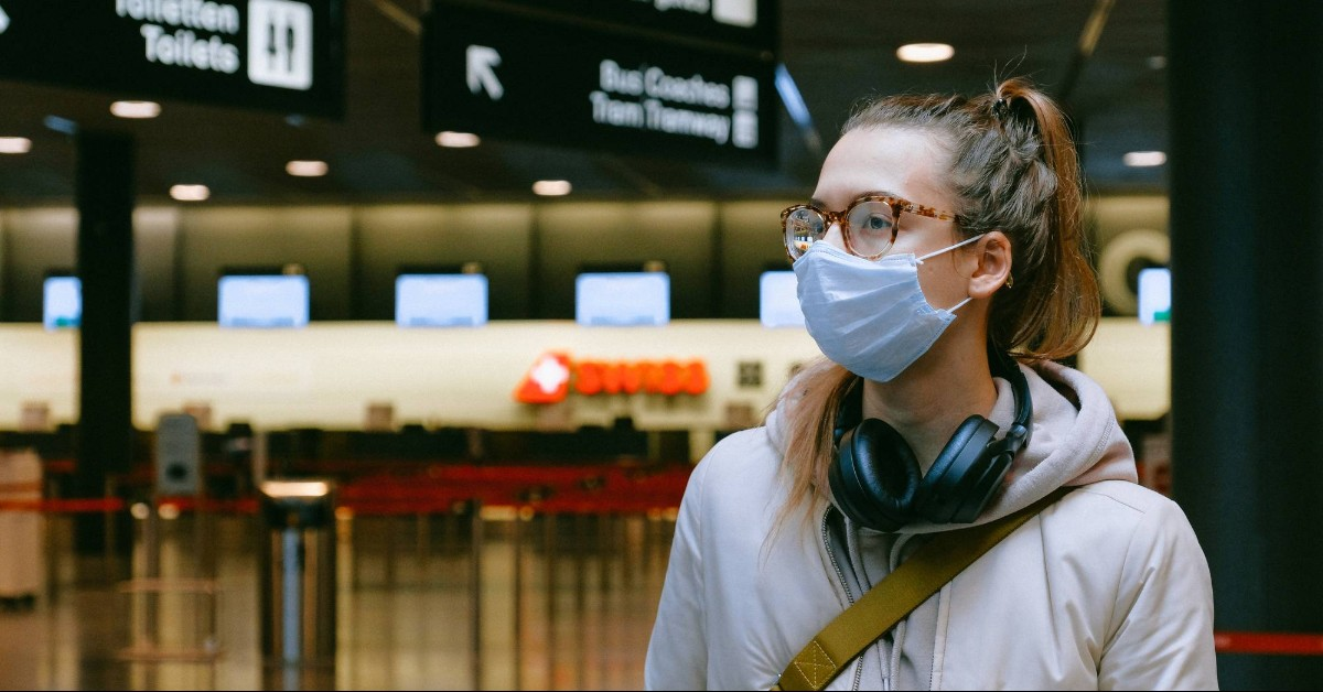 woman wearing face mask at the airport