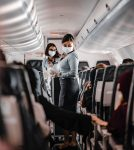 flight attendants wearing face mask on plane